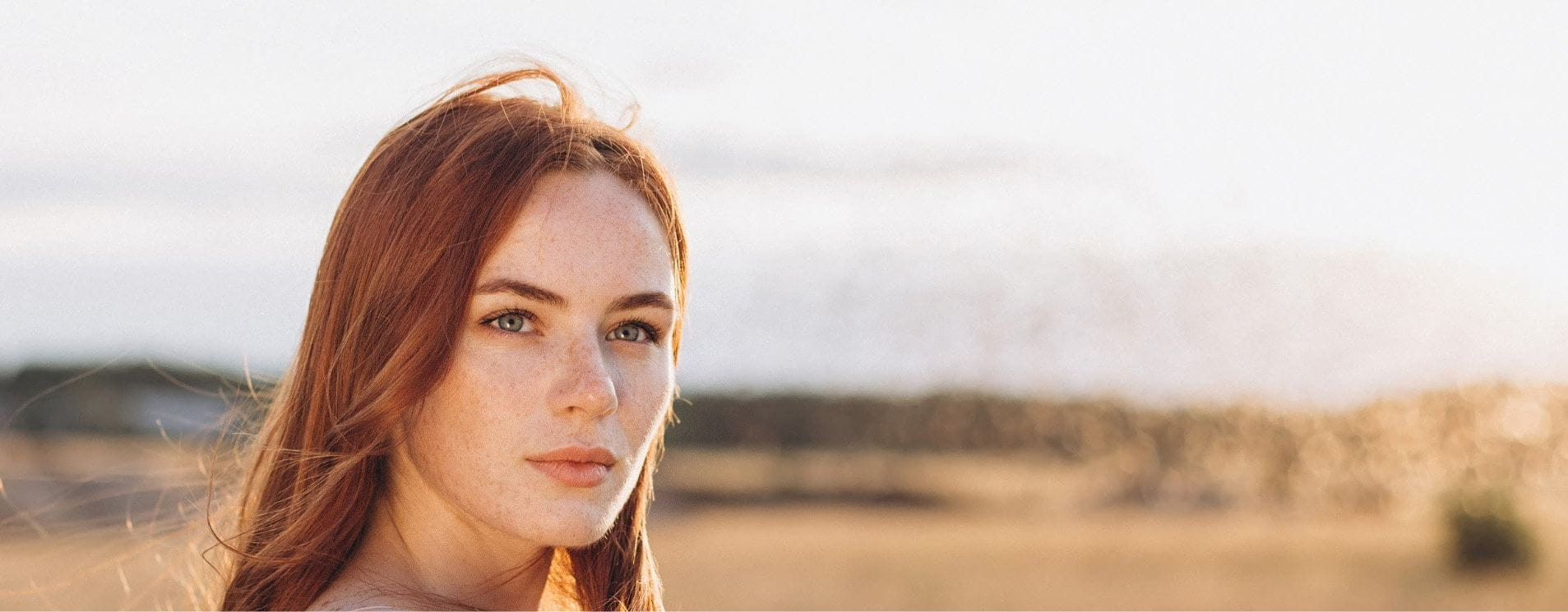 benefits of face masks girl with ginger hair in a field