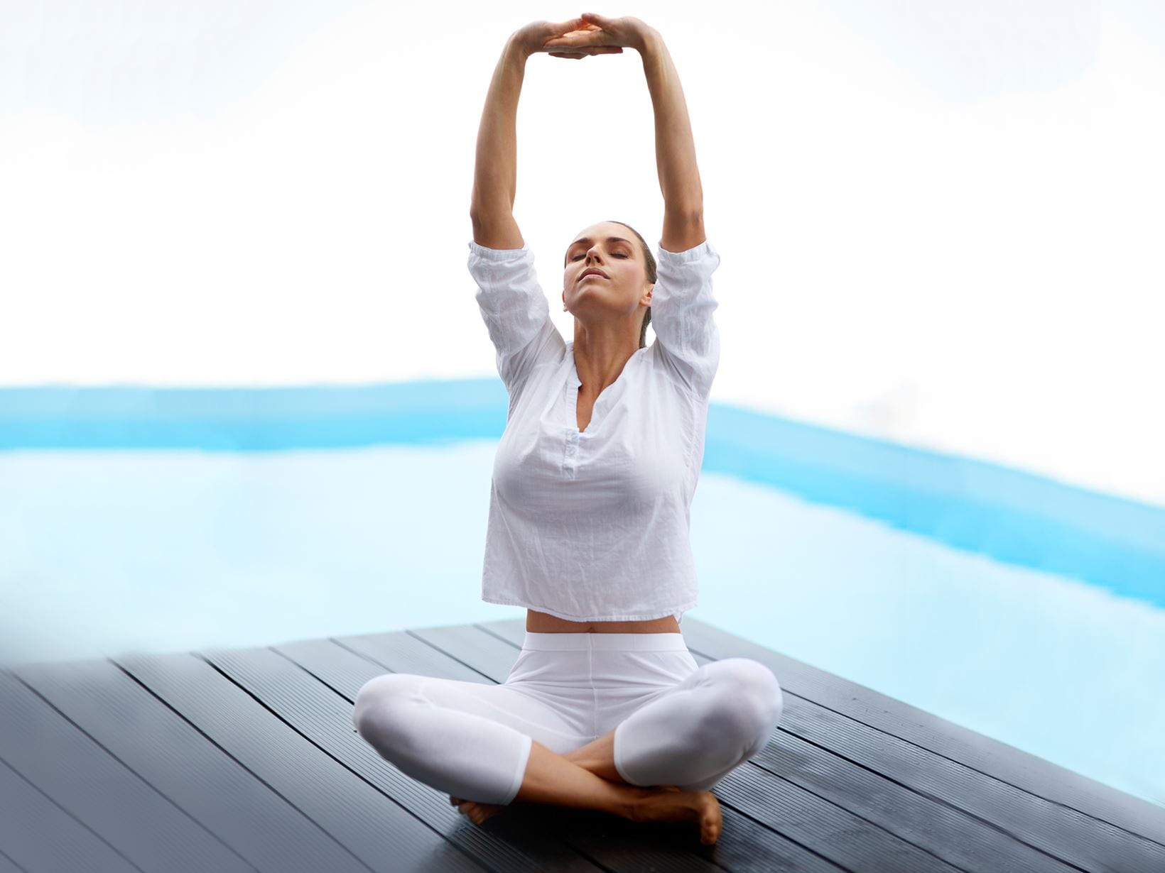 woman doing yoga to prevent excessive sweating