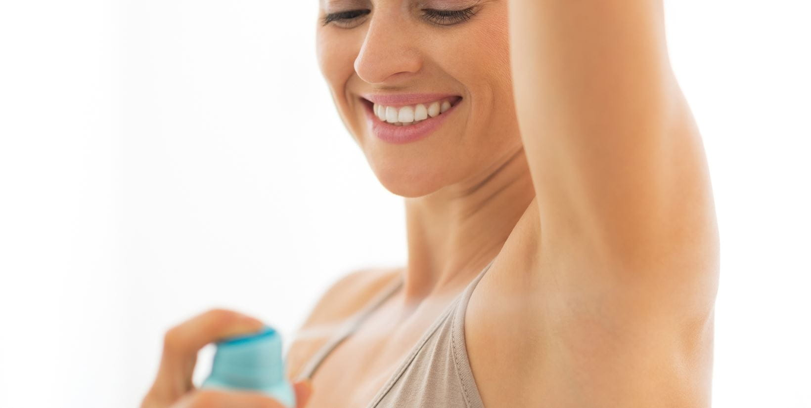 woman applying deodorant to prevent excessive sweating