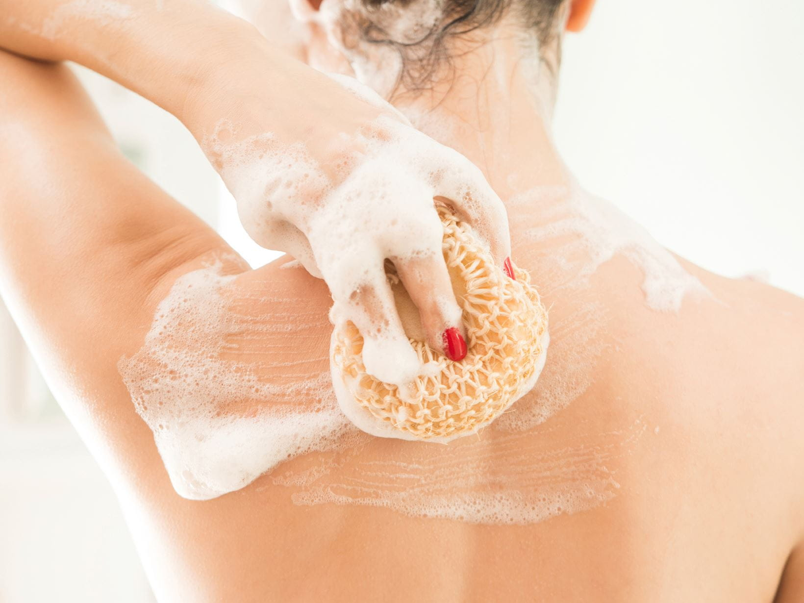 woman showing how to wash your body